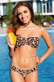 Beautiful girl with sunscreen lotion on her Stock Image