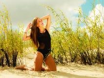 Beautiful sexy girl in swimwear on beach. Royalty Free Stock Image