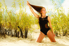 Beautiful sexy girl in swimwear on beach. Stock Photo