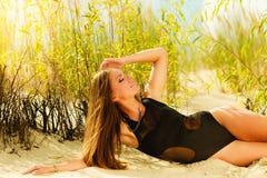 Beautiful sexy girl in swimwear on beach. Stock Images