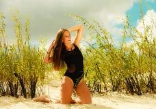 Beautiful sexy girl in swimwear on beach. Stock Photos