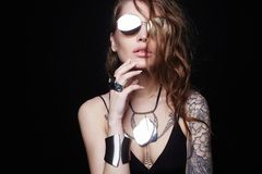 Beautiful sexy girl with tattoo, and sunglasses royalty free stock photo