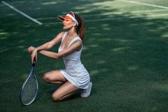 Beautiful girl on the court royalty free stock image