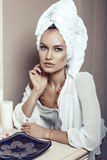 Beautiful sexy girl with towel on head and with bijou Royalty Free Stock Images