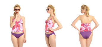 Beautiful sexy girl in a violet bathing suit isolated on white Stock Photos