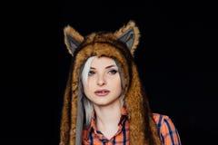 Beautiful girl wearing brown fur hat Stock Images