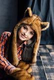 Beautiful sexy girl wearing brown fur hat Stock Image