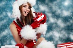 Beautiful girl wearing santa claus clothes Royalty Free Stock Photos