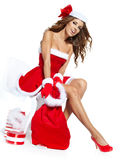 Beautiful sexy girl wearing santa claus clothes. With christmas gift Stock Image