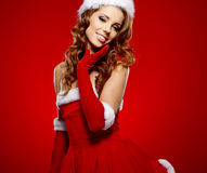 Beautiful sexy girl wearing santa claus clothes Royalty Free Stock Images