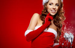 Beautiful sexy girl wearing santa claus clothes Stock Images