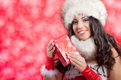 Beautiful sexy girl wearing santa claus clothes with christmas g Stock Photography