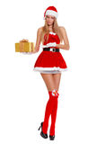 Beautiful sexy girl wearing santa claus clothes with christmas gift. Isolated on white Royalty Free Stock Photography