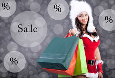 Beautiful sexy girl wearing santa claus clothes with color bag Stock Photos
