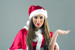 Beautiful sexy girl wearing santa claus clothes isolated Stock Photo