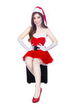 Beautiful sexy girl wearing santa claus clothes isolated on whit Stock Photo