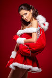 Beautiful girl wearing santa claus clothes stock image