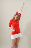 Beautiful sexy girl wearing santa claus clothes show succes gest Royalty Free Stock Images