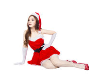 Beautiful sexy girl wearing santa claus clothes and sitting isol Stock Image