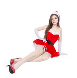 Beautiful sexy girl wearing santa claus clothes and sitting isol Royalty Free Stock Images