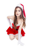 Beautiful sexy girl wearing santa claus clothes and sitting isol Royalty Free Stock Photography