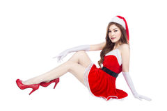 Beautiful sexy girl wearing santa claus clothes and sitting isol Stock Images