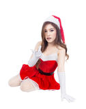 Beautiful sexy girl wearing santa claus clothes and sitting isol Royalty Free Stock Photos