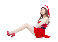 Beautiful sexy girl wearing santa claus clothes and sitting isol Stock Photos