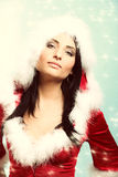 Beautiful sexy girl wearing santa claus clothes winter snow background Stock Photo