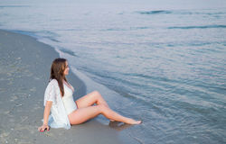 Beautiful sexy girl in a white bathing suit and tunic Royalty Free Stock Image
