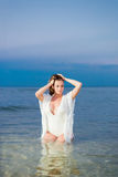 Beautiful sexy girl in a white bathing suit and tunic Royalty Free Stock Photography