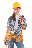 Beautiful girl in work wear holding tools isolated on white Stock Photos