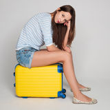 Beautiful sexy girl with a yellow suitcase loves to travel Royalty Free Stock Images