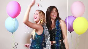 Beautiful sexy girls dancing with props in photo booth stock footage