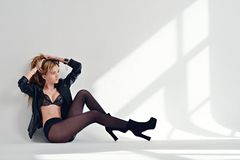 Beautiful sexy lady in elegant tights and bra Stock Images