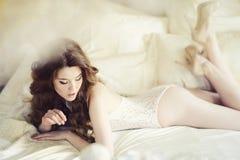 Beautiful sexy lady in elegant white bodysuit Stock Images