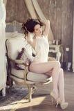 Beautiful sexy lady in elegant white bodysuit Stock Image