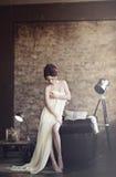 Beautiful sexy lady in elegant white dress Stock Photos