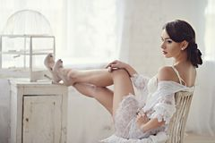 Beautiful sexy lady in elegant white panties and bra Royalty Free Stock Photography