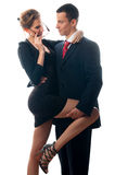 Beautiful lady seducing young businessman stock images