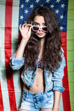 Beautiful long haired girl against american flag royalty free stock photos