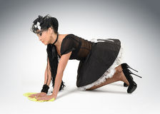 Beautiful sexy maid cleans the floor Royalty Free Stock Photography