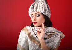 Beautiful sexy makeup woman in white fur winter hat, fashion sca Royalty Free Stock Photo