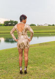 Beautiful Over Forty African American Woman. Outdoor full body portrait shot of a beautiful over forty year old African American woman dressed to attend an adult royalty free stock photos