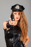 Beautiful sexy police girl with handgun Stock Photo
