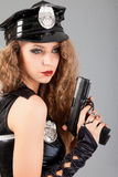 Beautiful sexy police girl with handgun Royalty Free Stock Image