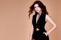 Beautiful sexy pretty girl wear black suit jacket and pants Royalty Free Stock Photo