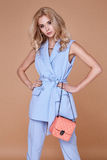 Beautiful sexy pretty girl wear blue suit jacket and pants skinn. Y body shape lady boss business woman skin tan long blond hair party style fashion cloches Stock Photos