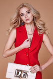 Beautiful sexy pretty girl wear red silk suit jacket and pants s. Kinny body shape lady boss business woman skin tan long blond hair party style fashion cloches Stock Image