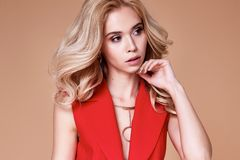 Beautiful sexy pretty girl wear red silk suit jacket and pants s. Kinny body shape lady boss business woman skin tan long blond hair party style fashion cloches Stock Photography